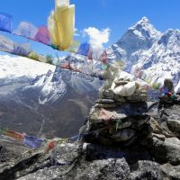 Local color: Cairns and Buddhist prayer flags like these punctuate the trek up to and back from Everest Base Camp.