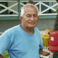 Where 79-year-old Joe de Brum runs a guesthouse. Meanwhile, with a storm brewing, fishermen sail off from Majuro in an outrigger.   CHRISTOPHER JOHNSON