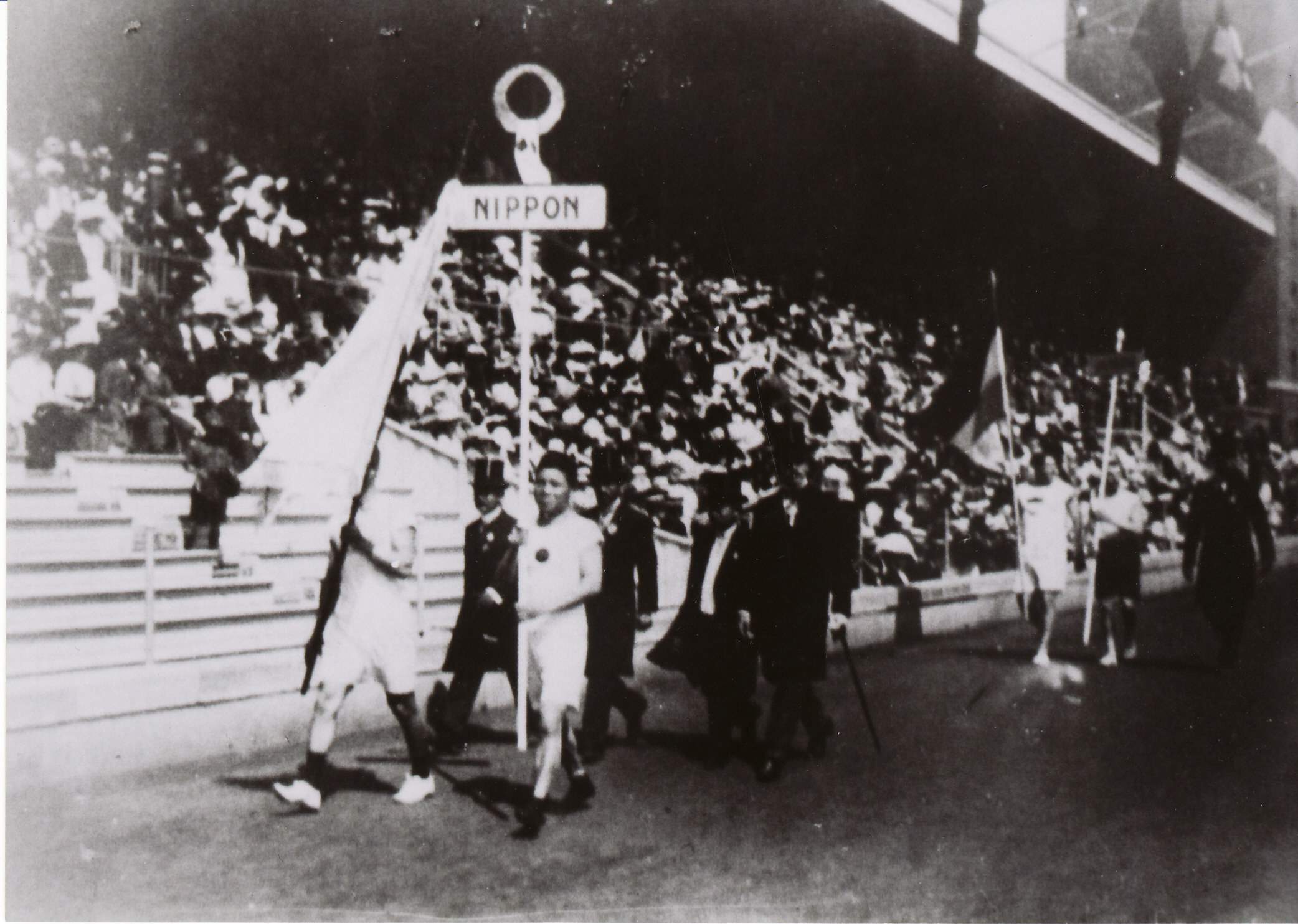 Glory days: Japan's first Olympians, Shiso Kanakuri (right) and Yahiko Mishima (holding flag), at the opening ceremony for the Stockholm Games in 1912.