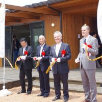 Bliah and French Ambassador Christian Masset (above, right) join Ishinomaki officials in a ceremony in early June to open the house, and pose with local residents inside the facility.