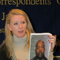 Named and shamed: Catherine Fisher — formerly known in media reports as Jane — holds a picture of rapist Bloke T. Deans at the Foreign Correspondents' Club of Japan in March. | SIMON SCOTT