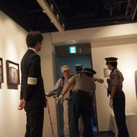 A visitor to Ahn's show gets a security check at the Shinjuku gallery. | JUNHEE JANG