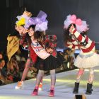 Eyeing the prize: Young models on stage at Tokyo Top Kids Collection, which was held at Yoyogi No.2 stadium, on Aug. 1, 2012 (above and below).