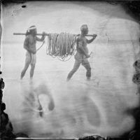 Collodion photography gives a 'timeless' atmosphere to an image of two men using traditional fishing methods on the prefecture's Kujukuri coastline. | EVERETT BROWN