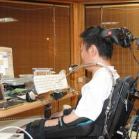Reaching out: A physically disabled employee of Qol Assist works from home.