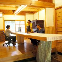 Open plan: Employees at a workstation recently added to Sansan's countryside office.