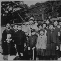 All together: Yoshiko Tatsumi (second from right, front row) with a group of family and friends on the day in 1937 when her father, Yoshio (center), was enlisted into the Imperial Army at the age of 41. He was afterward sent to serve in China.   YOSHIKO TATSUMI