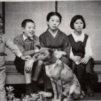 Home front: Yoshiko Tatsumi sits on the right by her mother, Hamako, in this snap from around 1940 that also shows her two brothers and the family's dog.   YOSHIKO TATSUMI
