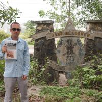 Faded glory: The author on the outskirts of Da Nang, Vietnam, at the main gate of Camp Reasoner as it is today. | JON MITCHELL PHOTOS