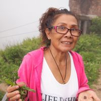 Scratching the surface: Tam Le shows off bullets found near a former military base and the herbs she used to flavor soups for U.S. GIs during the Vietnam War.