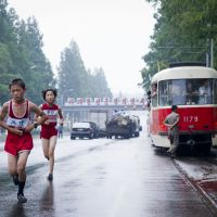 Giving their all: A road race between students was among the shots Ari Hatsuzawa captured during one of his stays in North Korea.