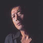 Eikichi Yazawa, as he is today, and as he imagines himself 30 years hence