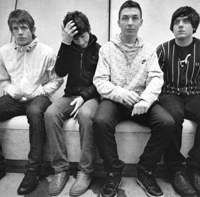 Arctic Monkeys (from left) guitarist Jamie Cook, lead vocalist Alex Turner, drummer Matt Helders and bassist Nick O'Malley. Below, the band play Zepp Tokyo on March 29 to promote their second album, 'Favourite Worst Nightmare.' | PEROU PHOTO (above); MITCH IKEDA PHOTO (below)