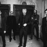 Anyone's ghosts: The National (from left): Aaron Dessner, Scott Devendorf, Matt Berninger, Bryan Devendorf and Bryce Dessner, were encouraged to write poppier songs by R.E.M. vocalist Michael Stipe.
