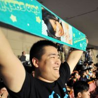 A Chinese fan waves a towel featuring AKB48's Rino Sashihara at a show in Shanghai the same month.   KYODO