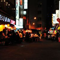 Under the rails: Patrons gather in the Yokocho area of Chiyoda Ward to drink with friends. Establishments in the area are offering two months of discounts to non-Japanese customers as a way to welcome tourists and visitors.