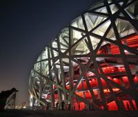 The Bird's Nest: A visitor takes a photograph of the Olympic stadium in Beijing. | AP PHOTO