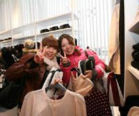 Fashion frenzy: Shoppers hunt for bargains at H&M's impressive new store in Harajuku. | © H&M