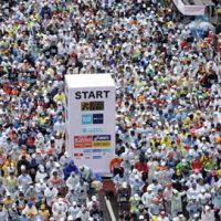 Thousands of runners fill the street in front of city hall during the start of the 2010 Tokyo Marathon. This year, 36,000 runners will participate in the annual event. | AP PHOTO