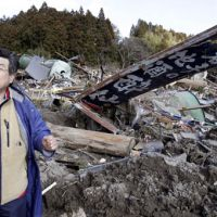 Determined to rebuild: Yasuhiko Konno, owner of Suisen sake brewery, stands in front of what used to be his brewery in Rikuzentakata, Iwate Prefecture. As the initial shock of the disaster fades, many are now focusing on rebuilding. | AP PHOTO