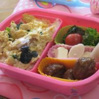 A bento is a packed lunch, usually arranged in a special box and including various small dishes and rice.