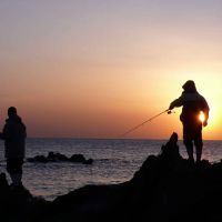 The slow life: Fishermen from Arasaki on the Miura Peninsula cast their lines at sunset. | ROBERT DE VIDO PHOTOS