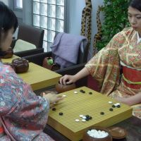 Game on: Yasuko Mantani (left) and Aya Kitano commence a game of go at the Shinsaibashi Igo Salon in Osaka. | AIMI NAKANO