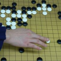 Making moves:  Go is a strategy game in which players seize territory on a board by surrounding areas with stones. Recently, more young women are enjoying the game, which is usually associated with an older generation of men. | AIMI NAKANO