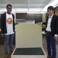 Cool tatami: Omotenashi House project leader Shota Tajima (right) and fellow project member Gordon Higgins show the tatami surface of one of the room's movable cooling benches.