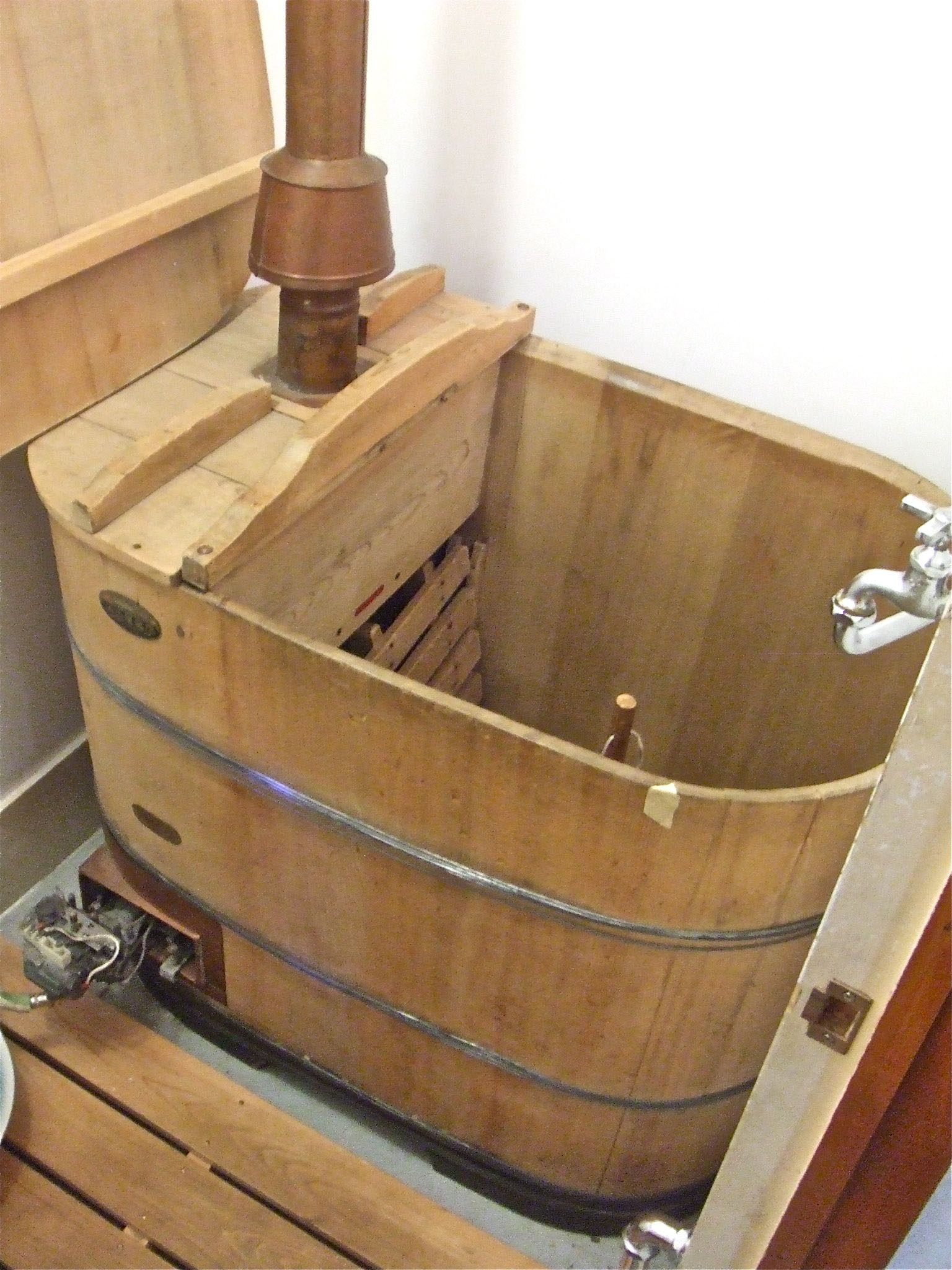 Retro charm: To heat the water for this old-style wooden bath, ...