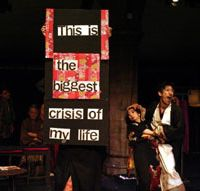 A scene from a production by Mugensha Theatre Company using signage for an English-language audience | MUGENSHA THEATRE COMPANY