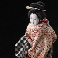 No strings: Ohatsu, the courtesan, dressed in a kimono made from an Hermes scarf, is operated by one puppeteer only, unlike other bunraku dolls that are manipulated by three.