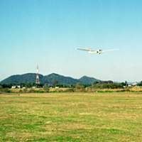A single-seat glider comes in to land at the Japan Soaring Club's airfield in Gunma Prefecture (top); some of the club's 150 members. Flights are operated year-round, and the club offers courses to beginners.
