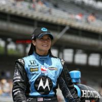 Girl power: Danica Patrick (above) has become a sensation at the track since winning an Indy 500 race at Japan's Twin Ring Motegi track in April. Below: Women are flocking to races because of Patrick, other women racers and clever marketing successes.