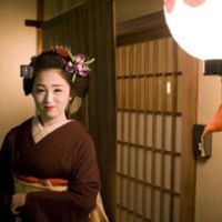 Ichimame, a maiko, stands outside an elite restaurant in the Kami Shichiken geisha district of Kyoto.   PERRIN LINDELAUF PHOTOS