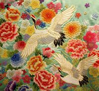 Cranes, believed to mate for life, are depicted in thousands of tiny knots on one of Chinzan-so's wedding kimonos.