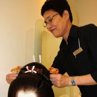 The aisle awaits: Toshie Nagamoto arranges priceless hair ornaments in a bride's wedding wig