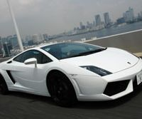 Supercar: Lamborghini's restyled Gallardo LP560/4, shown in a test drive around Tokyo, has a more aggressive look, larger frontal air scoops and a slimmer taillight design than its predecessor. | PETER LYON PHOTO