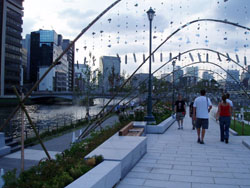 At ease: Some of the festival's 300,000 visitors to date enjoy strolling along the promenade of city-center Nakanoshima Island, the main venue for 'Suito Osaka 2009/Aqua Metropolis Osaka 2009' that runs until Oct. 12.