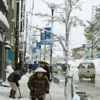In Tokamachi next morning, locals in conical sedge hats were clearing the sidewalks | SKYE HOHMANN PHOTOS