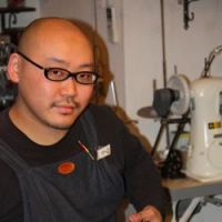 Yoshinori Tanaka, of leather-goods restoration shop Spica, makes rundown shoes fly again.
