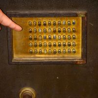Rich rewards: At his Safe and Key Museum — where a 1937 military safe (above) is among the items on display — Yasushi Sugiyama shows off an antique key shaped to fit round a pillar.