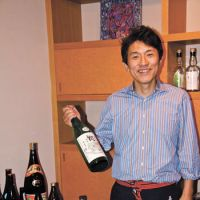Rich pickings: Mein (sake-tasting) host Shunji Shinoda at Isego Honten, and part of the breads bonanza to be had at Parito Fuwato.