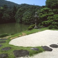 Glories not gone: A view of Kokokuji temple's simple and rather neglected, but still impressive, Edo Period dry-landscape garden, featuring an imposing stone lantern (above); garden trails leading to the surviving original castle donjon (below); and a wall figure (bottom) depicting the 1890 arrival of the Greek-Irish writer Lafcadio Hearn in Matsue, where he taught school for 15 months before being driven out by the region's harsh winters. | STEPHEN MANSFIELD PHOTOS