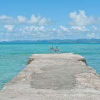 Blue heaven: Ishigaki Island forms the horizon from Taketomi. | STEPHEN MANSFIELD PHOTOS