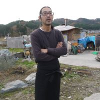 Norishige, a musician who has returned from Tokyo with his wife and their child to build and run Cafe & Bar Ape in his Iwate hometown of Otsuchi.