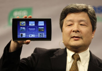 Multifunctional: Shiro Kitajima, president of Panasonic Consumer Electronics Co., holds up a Viera Tablet during a press preview for the Consumer Electronics Show in Las Vegas on Wednesday.   AP PHOTO