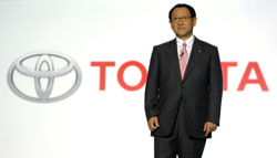 'Onigiri'-inspired: Akio Toyoda, president of Toyota Motor Corp., speaks at the Detroit auto show Monday, vowing the carmaker will add the tender loving care that goes into a mother's homemade rice balls.   AP PHOTO