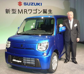 Latest style: Suzuki Motor Corp. President and Chairman Osamu Suzuki poses in front of the firm's fully remodeled MR Wagon minivan, which went on sale Thursday. | KYODO PHOTO