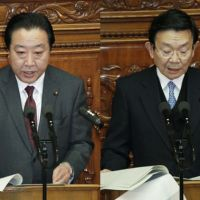 Game plan: Finance Minister Yoshihiko Noda (left) and economic and fiscal policy minister Kaoru Yosano deliver separate speeches Monday in the Diet | KYODO PHOTO
